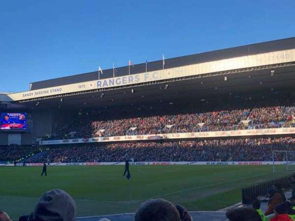 Ibrox Stadium , sección: SE1, fila: H, asiento: 0019